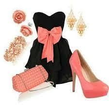 A black strapless dress with a pink bow and pink heels