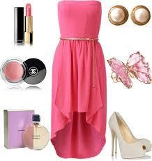 A pink strapless dress with white heels
