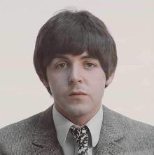 Definitely Paul McCartney. His vocals in Lovely Rita are similar to it. The backgrounds are clearly John.