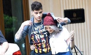 Perrie Edwards covers Zayn Malik's rude T-shirt as she shelters under his hoodie during romantic stroll | Mail Online