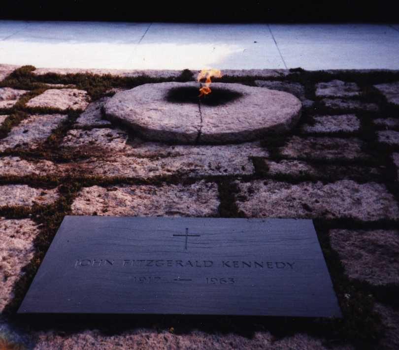 Kennedy's grave in Arlington National Cemetery is marked by what?