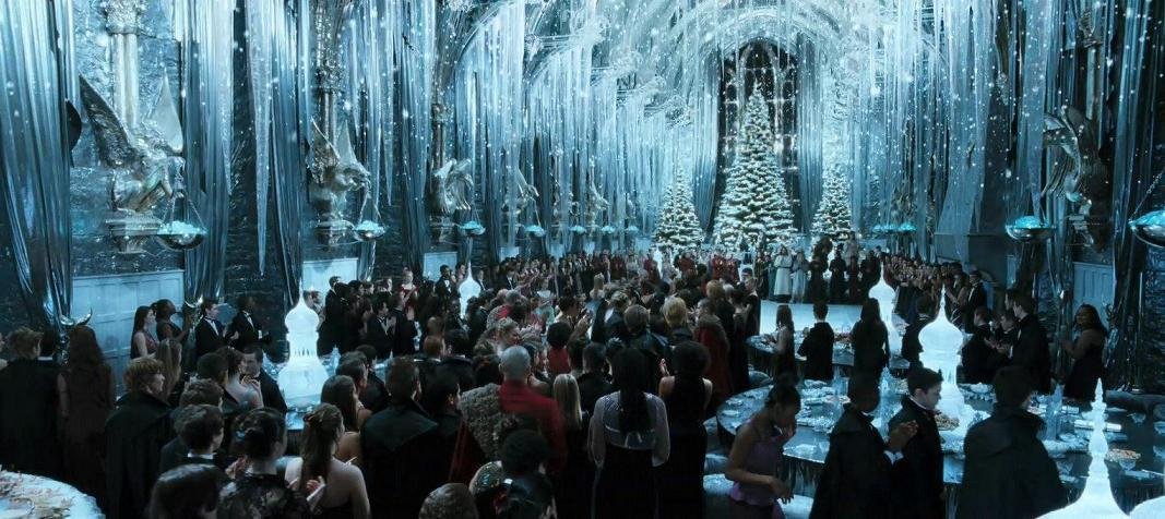 Who did Ron, Harry and Hermione go to the Yule Ball with?
