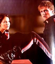 When did Katniss relize that she loved peeta