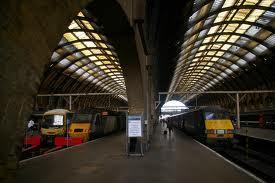 9) At which station and on what platform do students board the train to Hogwarts?