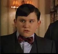 What is the name of the actor who plays the role of Harry's cousin Dudley who is loved very much by his family and gets anything he wants when he wants it throughout the entire Harry Potter series?