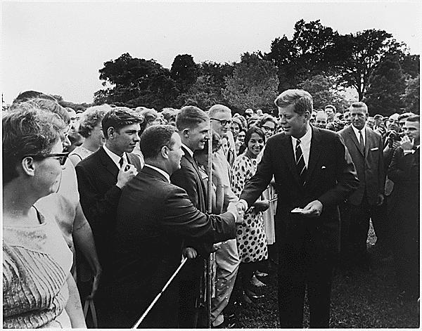 During his tenure, Kennedy created a new organization that used skilled American volunteers to aid underdeveloped countries in need. What was this organization called?