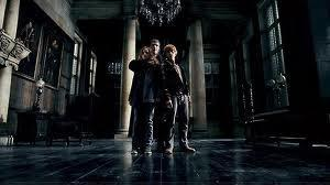 When held hostage at Malfoy Manor what is the name of the death eater who is torturing Hermione as she believes Hermione has broken into her vault at Gringotts?