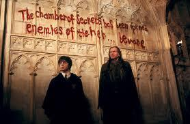 during the chamber of secrets there had been a few attacks on muggleborn students and students could tell all staff members was scared when they had seen an annoucemnt saying the chamber of secrets had be opened again,students didnt know what it all meant so which of these characters had been the professor that had explained to the students about the chamber itself?