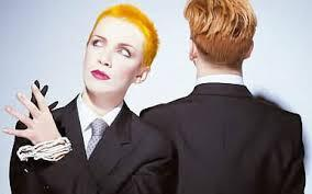 Which Eurythmics song featured the lead singer in a suit at a board meeting at the start of the video.