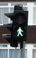 You want to cross the road and ahead of you is a road crossing (Pelican crossing). As you reach it the lights show the green man flashing. Can you..