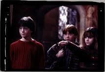What was the name of the Hogwarts student who tried to stop Harry,Ron and Hermione from leaving the Gyffindor Common room to sneak to the 3rd floor corridor and try their hardest to stop the Philosophers Stone from being taken?