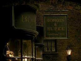 When Harry,Ron and Hermione tail Draco Malfoy and his mother to Borgin and Burkes in Harry Potter and the Half Blood Prince what is the name of the death eater who was keeping watch for them?