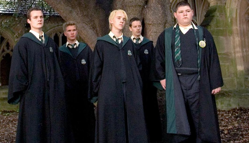 You are walking through a corridor and see a kid who you don't know being bullied by Slytherins. What do you do?