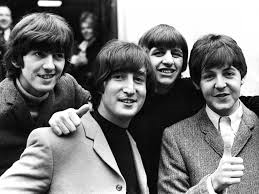 What Song Was The Beatles first hit in Great Britain?