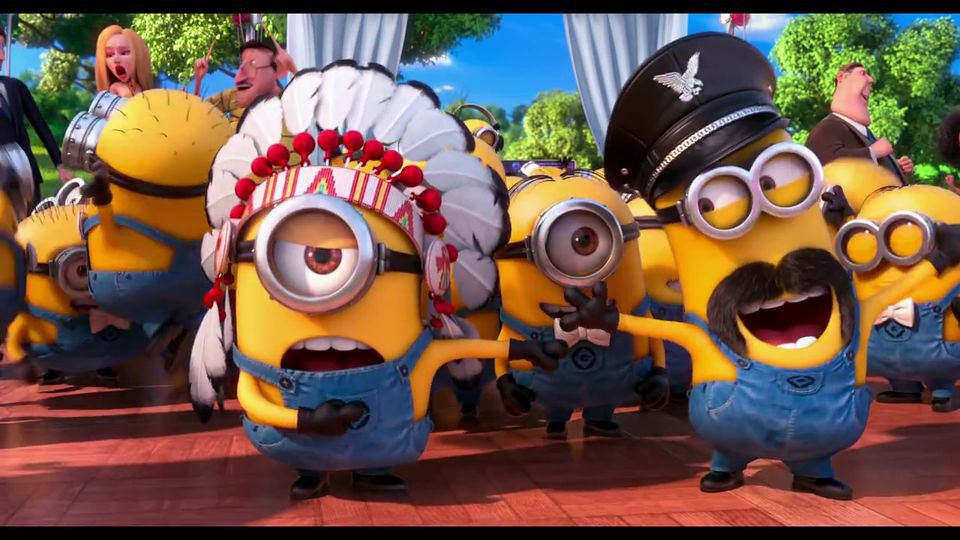 At the end of the movie, what song do the minions sing in gibberish?