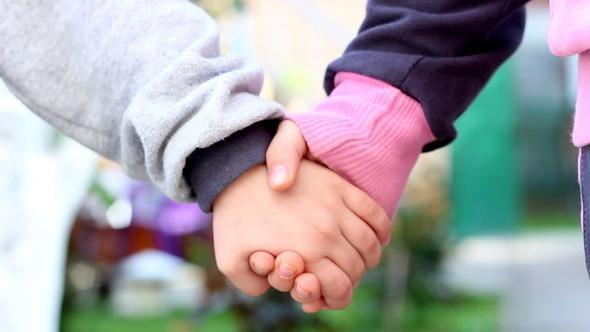 As a punishment for fighting at school, two kids could either be suspended or hold hands for an hour.