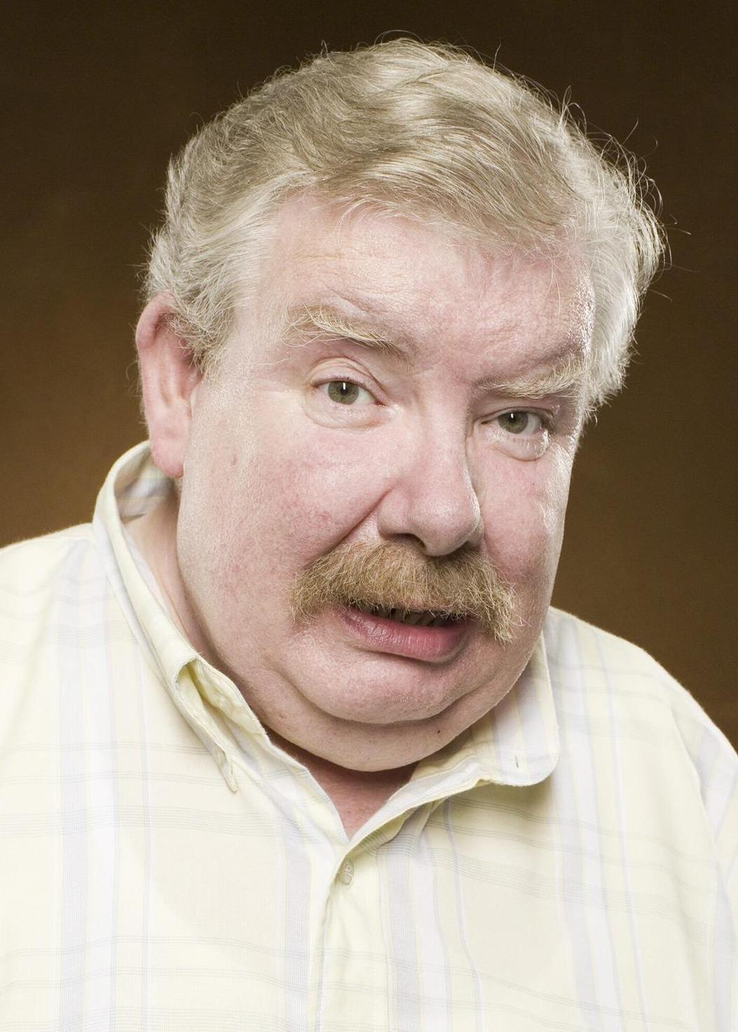 Where does  Vernon Dursley work at?