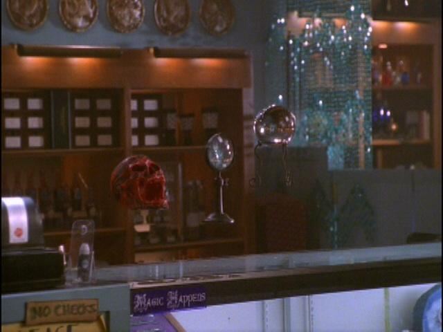 What is the magic store that Giles owns called?