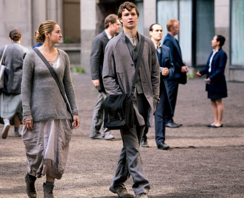 What was the name of the boy who is Tris' neighbor when she is still in abnegation?