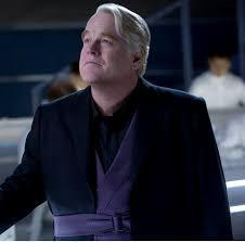 What did Plutarch Heavensbee fall into after Katniss shot the arrow at the pig?