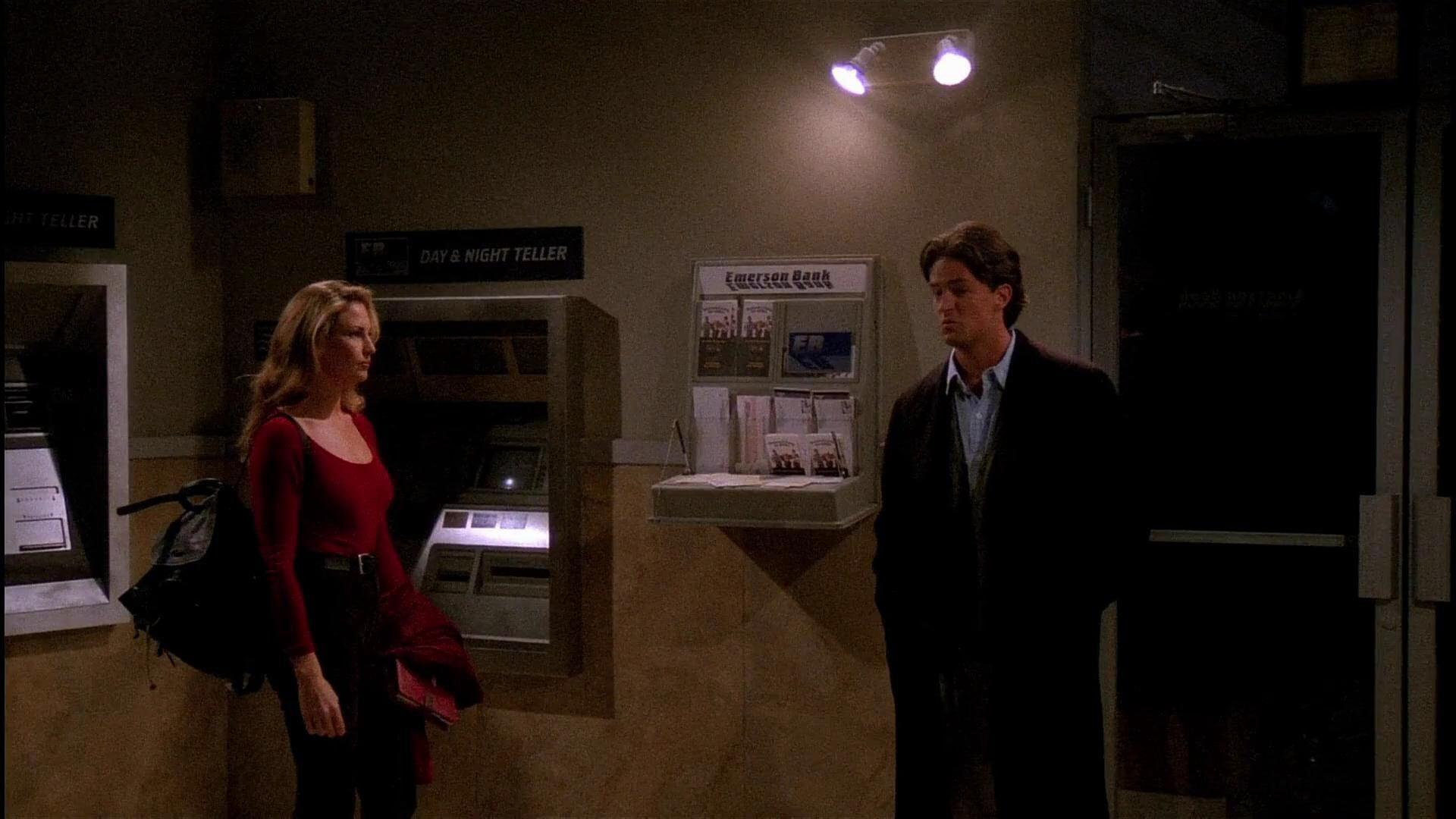 During the blackout, who was Chandler locked in with at the ATM Vestibule?