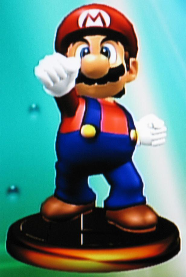 In Super Smash Bros. Melee (Gamecube), which trophy of Mario describes Mario's mass? (Not offensively.)