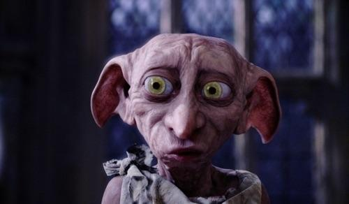 What house elf breaks into Harry's room in Chamber of Secrets?