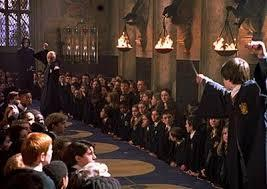 What was the name of the Hogwarts student who after seeing Harry using parseltounge talking to a snake at the dueling club believed that Harry was the air of Slytherin and was planning on attacking next?