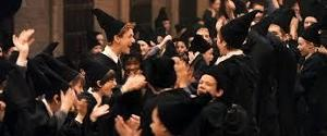 Which of the four Hogwarts School Houses came last with houses points after Gyffindor after been given extra points had moved up into first place in Harry Potter and the Philosophers Stone?