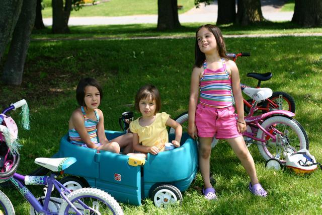 While in the park everyone gets tired of walking. The girls rented a little wagon so you can pull em in. You..