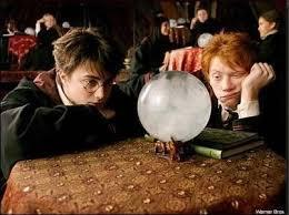 What grade did harry and ron get in divination?