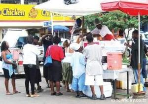 The picture below shows a doubles vendor,the type of business can be classified as: