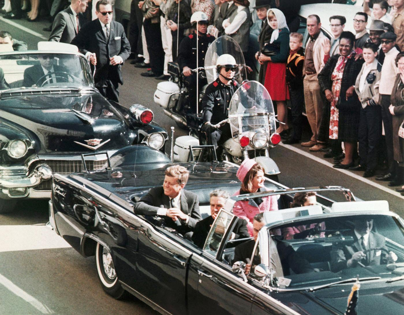 During the ambush that killed Kennedy, who else riding in the motorcade was wounded?