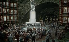 when harry Ron and hermione break into the ministry of magic which one of these ministry members now working for Voldemort chases them through the atrium hoping to catch them to hand them all over to Voldemort?