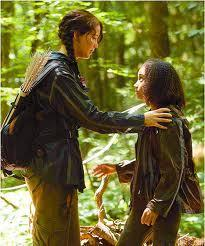When Rue died, Katniss sang which song to her?