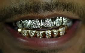Which of these rappers have grills?