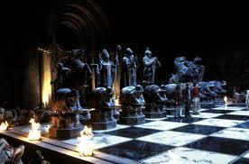 when leading harry and hermione in a game of wizards chess which position does Ron say he will take?