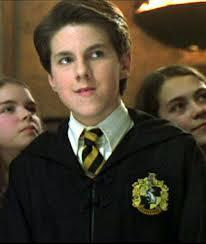 Which of the four Hogwarts School Houses did Justin Finch-Fletchy belong to during his time as a Hogwarts student?