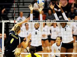 If your blocking the other teams hitter, can your hand touch the net?