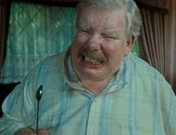 Vernon Dursley does his best to prevent Harry from getting his hands on his letters sent unknown to Harry from Hogwarts, when just sitting in the cupboard under the stairs Harry hears a noise, what does Harry see his uncle Vernon doing to prevent any letters getting in?