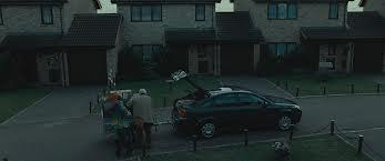 In Harry Potter and the Deathly Hallows Part 1 Harry watch as his family are packing the car getting ready to leave and go into hiding to stay safe in case Voldemort goes after them for information on Harry and his whereabouts, which member of the Dursley family comes up to Harry and shakes his hand before they go?