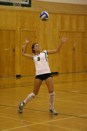 If you are serving the ball over to the other side, can you step on the outline while serving the ball?
