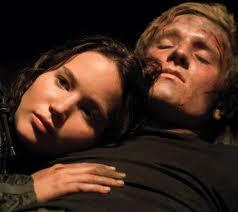 In catching fire what did peeta say to katniss that she couldnt quite catch before she dranged under by morphling