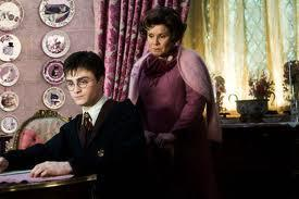 In harry potter and the order of the phoenix, what does umbridge make harry write as his punishment which gets engraved onto his hand?