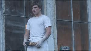 What month did Peeta give Katniss the bread?