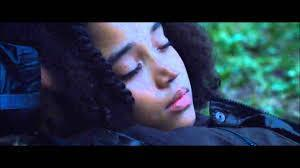 When Rue dies, what does Rue whisper to her, THE FIRST THING?