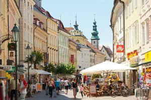 Which city is the educational and political center of Slovenian national minority in Austria?